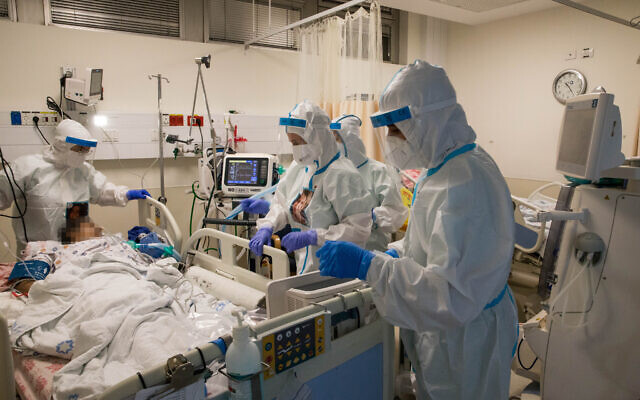 Healthcare workers wearing protective clothes as they work at the coronavirus ward of Shaare Zedek hospital in Jerusalem on September 23, 2020. (Nati Shohat/Flash90)
