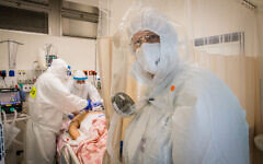Hospital team members work at the coronavirus ward of Shaare Zedek hospital in Jerusalem on September 23, 2020 (Nati Shohat/Flash90)