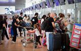 Passengers at the Ben Gurion International Airport during a nationwide lockdown, on September 24, 2020. (Avshalom Sassoni/Flash90)