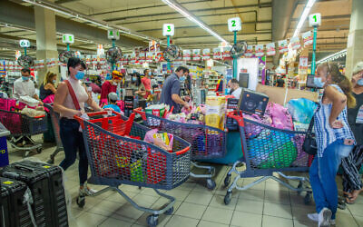 People shop for groceries at the Rami Levy supermarket in Modi'in on September 24, 2020. (Yossi Aloni/Flash90)