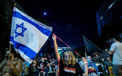 Following social-distancing regulations, protesters rally against Prime Minister Benjamin Netanyahu, outside his official residence in Jerusalem on September 24, 2020. (Yonatan Sindel/Flash90)