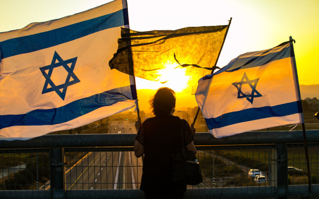 An Israeli protests against Prime Minister Benjamin Netanyahu from a bridge in the Jezreel Valley on September 26, 2020. (Anat Hermony/Flash90)