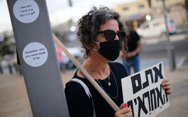 "An Israeli protester in Tel Aviv on September 29, 2020. The sign reads ""You are responsible."" (Tomer Neuberg/Flash90)"