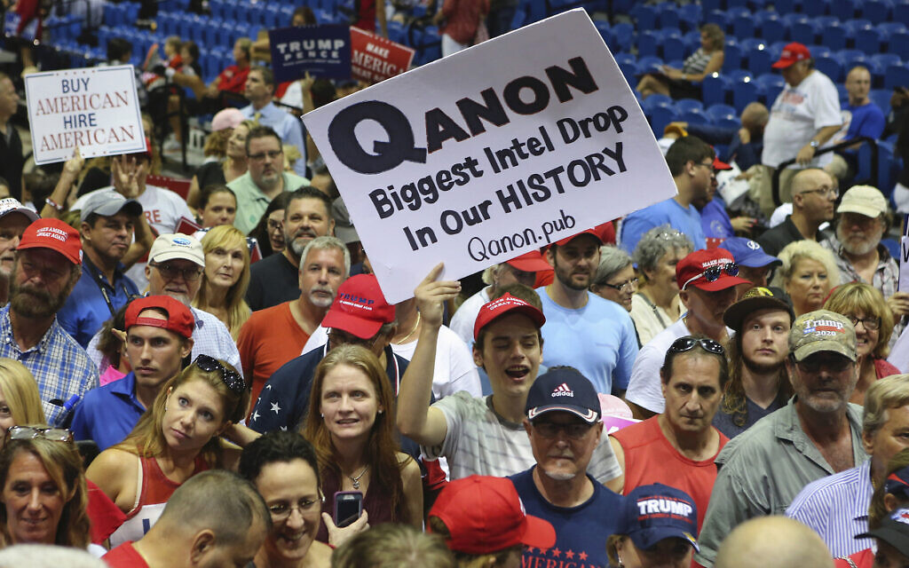 Trump supporters displaying QAnon posters appeared at US President Donald Trump's rally, July 31, 2018 at the Florida State Fair Grounds in Tampa Florida (Thomas O'Neill/NurPhoto via JTA)