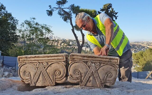 The unveiling of a column head found at a dig at Armon HaNatziv, Jerusalem (Yoli Schwartz, Israel Antiquities Authority)