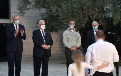 From left, Defense Minister Benny Gantz, President Reuven Rivlin, IDF chief Aviv Kohavi and former national security adviser Yaakov Amidror give the Israel Security Prize to a recipient at the President's Residence in Jerusalem on September 13, 2020. (Kobi Gideon/GPO)