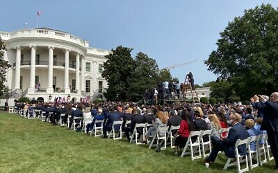 People seated whle awaiting the start of a ceremony for the signing of agreements between Israel and the UAE and Bahrain at the White House in Washington, DC, on September 15, 2020. (Jacob Magid/Times of Israel)