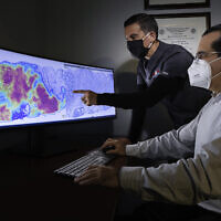 Pathologists at CorePlus in Puerto Rico reviewing a cancer heatmap generated using AI technology developed by Israel's Ibex Medical Analytics. (Courtesy)