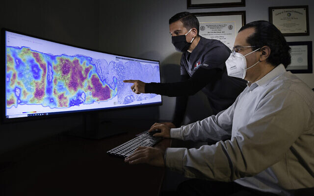 Pathologists at CorePlus in Puerto Rico  reviewing a cancer heatmap generated using AI technology developed by Israel's Ibex Medical Analytics (Courtesy)