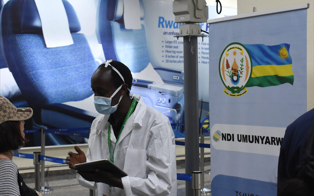A Rwandan Health Ministry worker screens arriving passengers for COVID-19 infections at Kigali International Airport, February 2020. (Larry Luxner/Times of Israel)