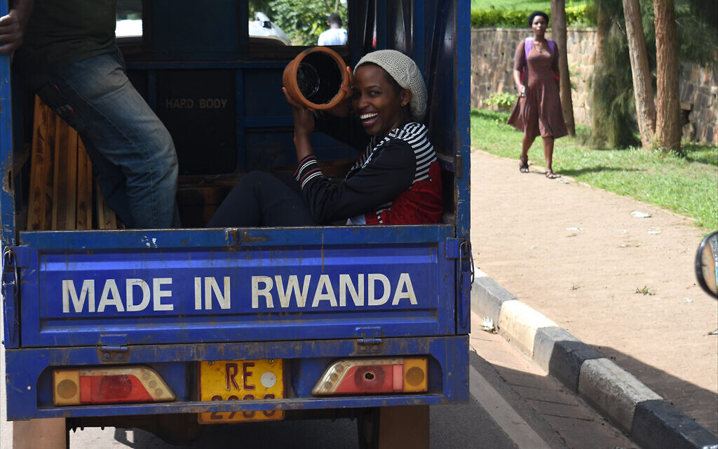 Truck bearing proud 'Made in Rwanda' banner in Kigali traffic, February 2020. (Larry Luxner/Times of Israel)