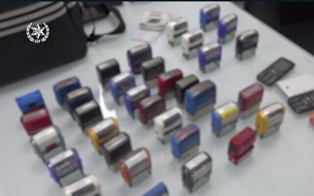 Screen capture from video of stamps seized by police during an investigation into a large-scale tax offenses and money laundering case. Image blurred to protect the identity of victims of the scam. (Israel Police)