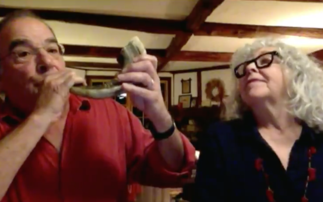 Mandy Patinkin blows a shofar next to his wife Kathryn Grody on MSNBC. (Screen capture: Twitter)