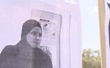 Screen capture from video of a picture of Sharifa Abu Muammar displayed on the gates of the school where she taught, September 1, 2020. (Channel 12)