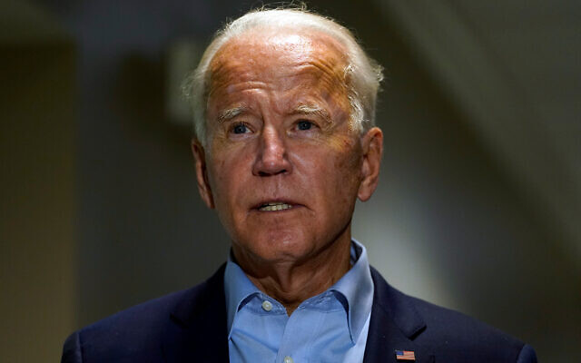 Democratic presidential candidate Joe Biden speaks about the death of Supreme Court Justice Ruth Bader Ginsburg after he arrives at New Castle Airport, in New Castle, Delaware, September 18, 2020. (AP Photo/Carolyn Kaster)