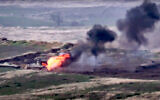 In this image taken from a footage released by Armenian Defense Ministry, Armenian forces destroy an Azerbaijani military vehicle at the contact line of the self-proclaimed Republic of Nagorno-Karabakh, Azerbaijan, September 27, 2020. (Armenian Defense Ministry via AP)
