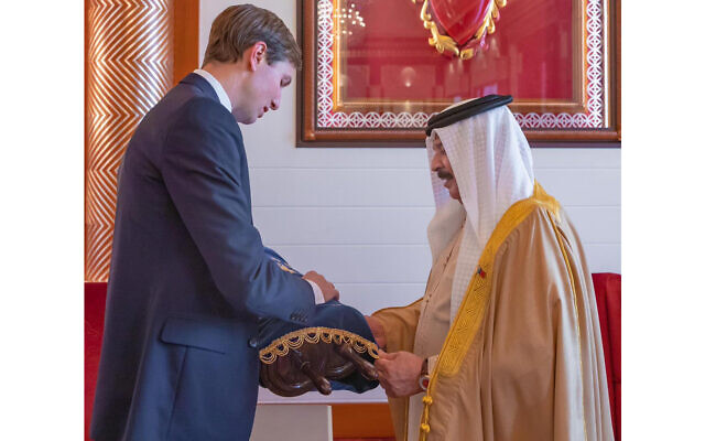 White House senior adviser Jared Kushner presents a Torah scroll to Bahrain's king, Hamad bin Isa Al Khalifa, while visiting the Gulf state in early September, 2020. (Twitter/Avi Berkowitz)