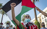 Moroccans wave the Palestinian flag during a demonstration against Israel-UAE-Bahrain normalization agreements in the capital Rabat, September 18, 2020. (Fadel Senna/AFP)