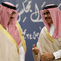 Saudi Interior Minister Prince Mohamed bin Nayef Al Saud, left, and Bahraini Interior Minister Sheik Rashid bin Abdullah Al Khalifa, right, speak together during a Gulf Cooperation Council interior ministers gathering to discuss security issues in Manama, Bahrain, November 28, 2013. (AP Photo/Hasan Jamali)