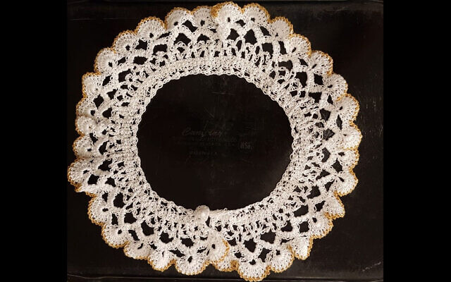 One of the late Supreme Court Justice Ruth Bader Ginsburg's signature white lace jabot collars will go on display at the Museum of the Jewish People in Tel Aviv. (Courtesy/Museum of the Jewish People via JTA)