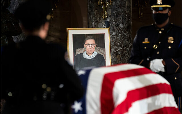 The flag-draped casket of Justice Ruth Bader Ginsburg lies in state in the US Capitol, Sept. 25, 2020. (Erin Schaff/The New York Times via AP, Pool)