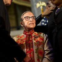 Justice Ruth Bader Ginsburg is greeted on stage by members of congress and their staffs during an annual Women's History Month reception at Statuary Hall on Capitol Hill in Washington, March 18, 2015. (AP Photo/Pablo Martinez Monsivais)