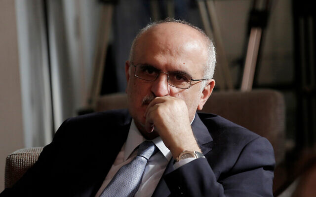 Then-Lebanese finance minister Ali Hassan Khalil listens to Lebanese Information Minister Jamal Jarrah while he speaks to a journalist at the Government House in Beirut, Lebanon, May 24, 2019. (AP Photo/Hassan Ammar, File)