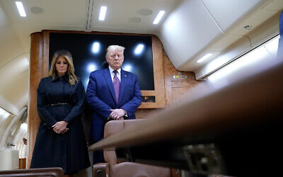 US President Donald Trump and first lady Melania Trump pause for a moment of silence on Air Force One as he arrives at the airport in Johnstown, Pennsylvania, on his way to speak at the Flight 93 National Memorial in Shanksville, Pennsylvania, September 11, 2020. (AP Photo/Alex Brandon)