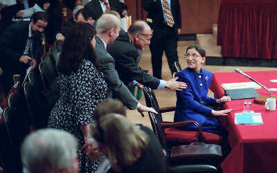 Ruth Bader Ginsburg is greeted by her husband Martin during her confirmation hearing before the Senate Judiciary Committee on Capitol Hill in Washington, July 20, 1993. (AP Photo/John Duricka)