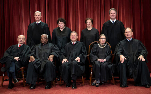 US Supreme Court justice gather for a formal group portrait at the Supreme Court Building in Washington, November 30, 2018. Seated from left: Associate Justice Stephen Breyer, Associate Justice Clarence Thomas, Chief Justice of the United States John G. Roberts, Associate Justice Ruth Bader Ginsburg and Associate Justice Samuel Alito Jr. Standing behind from left: Associate Justice Neil Gorsuch, Associate Justice Sonia Sotomayor, Associate Justice Elena Kagan and Associate Justice Brett M. Kavanaugh. (AP Photo/J. Scott Applewhite, File)