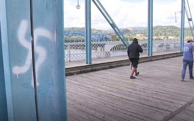 Screen capture from video of a swastika painted on the Walnut Street Bridge in Chattanooga, Tennessee, September 13, 2020. (News Channel 9)