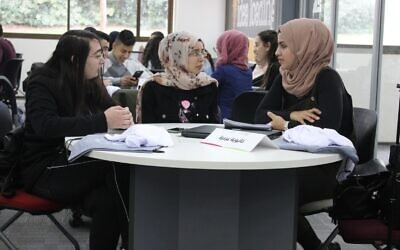Arab students take part in a Makeathon in 2020 at Tel Aviv University organized by Tsofen. A Makeathon is when teams work to build new products (Courtesy)