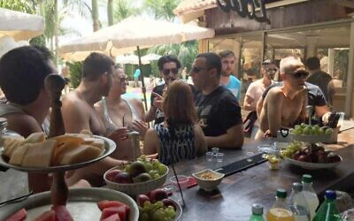 Employees of Liantech, the company behind Lbinary and Ivory Option, enjoying a poolside employee party on August 7, 2016 (Facebook)