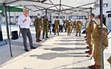 Defense Minister Benny Gantz, left, speaks to IDF soldiers during a visit to the IDF Central Command in Jerusalem, on September 15, 2020. (Ariel Hermoni/Defense Ministry)