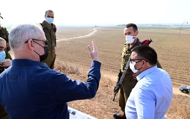 Defense Minister Benny Gantz (L) tours the Gaza front alongside military officials, Sptember 16, 2020 (Ariel Hermoni/Defense Ministry)