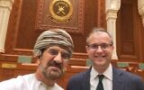 Sigurd Neubauer, right, with a senior Omani official at Oman's Consultative Assembly, Muscat 2019 (courtesy)