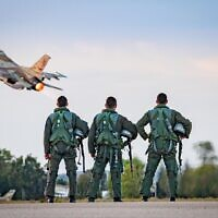 Illustrative. Three pilots stand in front of an F-16 fighter jet as it takes off from the Israeli Air Force's 117th Squadron, which was closed on September 30, 2020. (Israel Defense Forces)