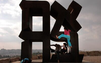 A child climbs onto the 'Ahava'/Love statue in the Israel Museum in Jerusalem on December 21, 2006. In 1978, the American artist, Robert Indiana, created a 13-foot-tall steel sculpture. (Lara Hart /Flash90)