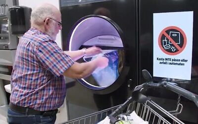 Putting used cans and bottles into an automated compression machine that delivers a voucher to return deposits paid in advance. (Screenshot Tomra Group)