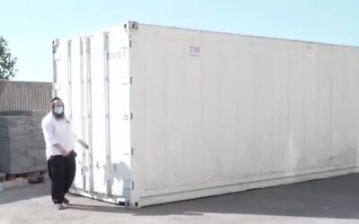 A refrigerated shipping container prepared by the Haifa Chevra Kadisha burial society for holding bodies of coronavirus patients ahead of an expected spike in the pandemic's death toll, September 22, 2020. (Channel 13 screen capture)