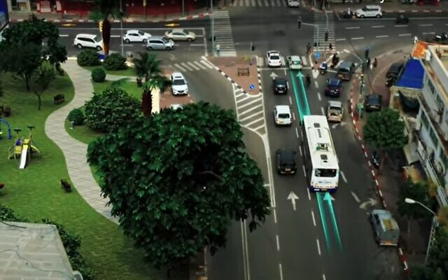 Illustration of an electric bus traveling along a stretch of Electreon smart road, recharging as it travels. (ElectReon screenshot)