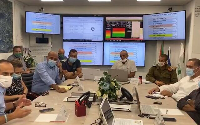 Coronavirus czar Ronni Gamzu (front left) speaks at a meeting with local Arab leaders in Daliat el-Carmel, September 5, 2020. (Screen grab/Kan)