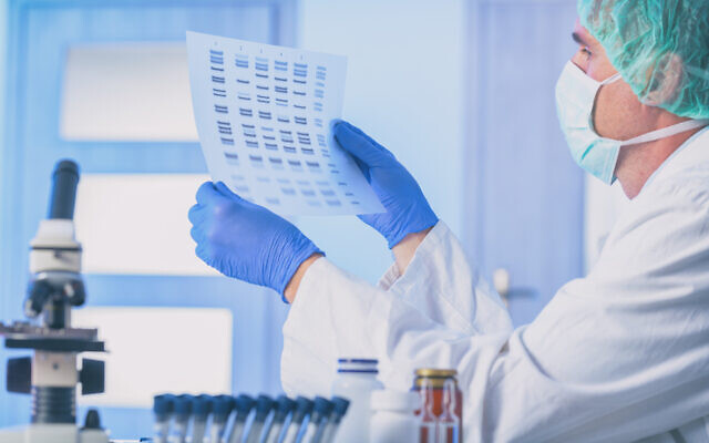 A scientist in a genetic testing lab (iStock)