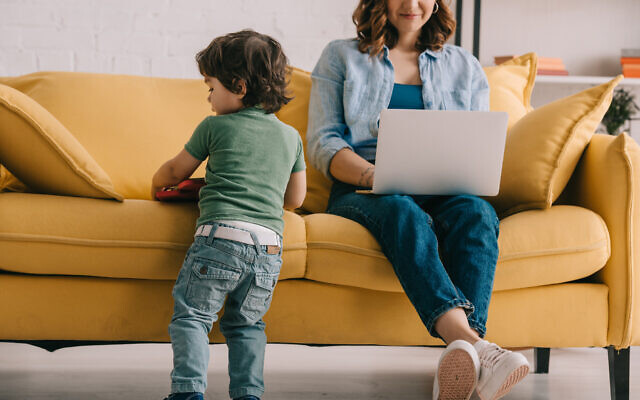 An illustrative image of a mother working from home (LightFieldStudios; iStock by Getty Images)