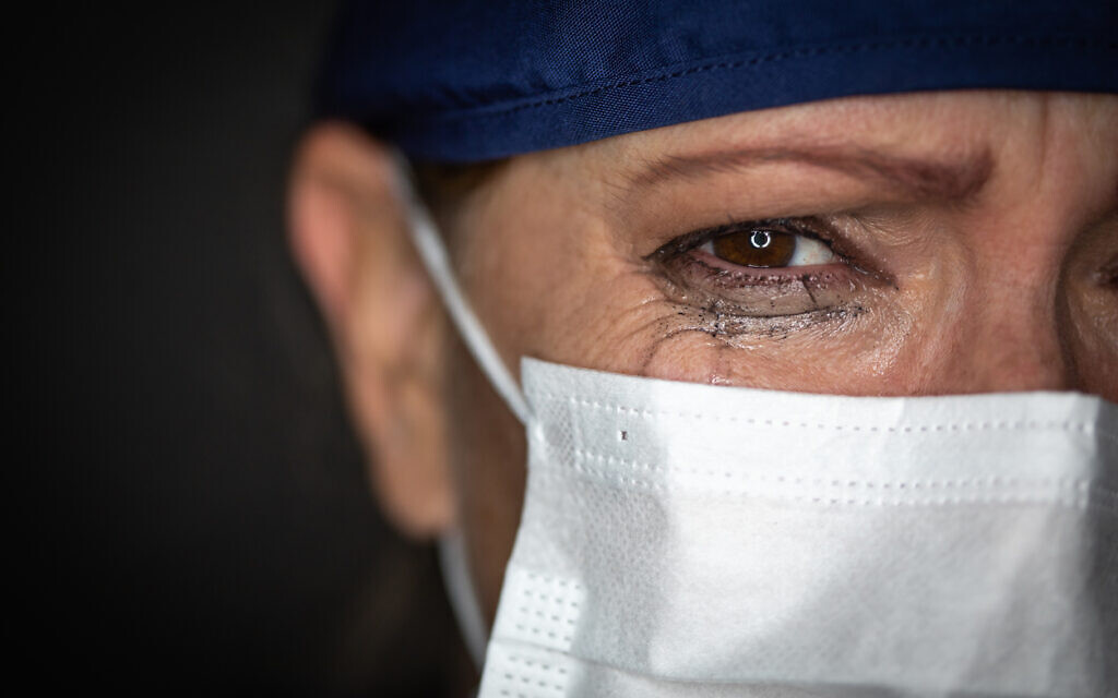 A medical professional sheds a tear over the human cost of the pandemic (iStock)