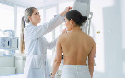 A patient receives a mammogram. (iStock)