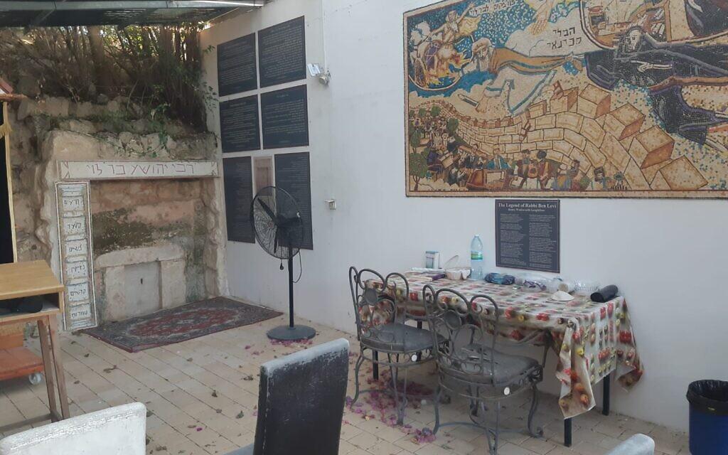 The mural created by Avi Katz for Mitch Pilcer's Tzippori home and the restored gravesite of Rabbi Yehoshua Ben Levi, the Ribal (Courtesy Avi Katz)