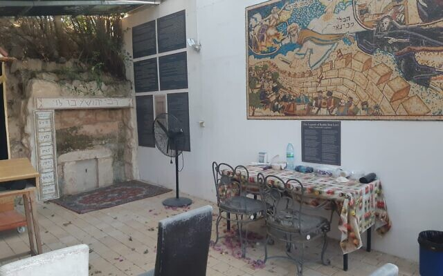 The mural created by Avi Katz for Mitch Pilcer's Tzippori home and the restored gravesite of Rabbi Yehoshua Ben Levi, the Ribal (Courtesy Avi Katz)