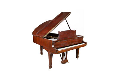 A piano that belonged to Władysław Szpilman is going up for auction. (Desa Uninicum via JTA)