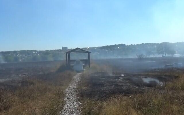 Grass smolders after a fire at a Jewish cemetery in Uman, Ukraine, August 31, 2020 (Screen grab)